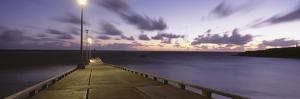 Pier and Coastline Just before Dawn by Design Pics Inc