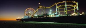 Rollercoaster and Ferris Wheel at Dusk on the Santa Monica Pier by Design Pics Inc