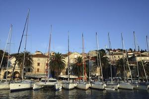 Sailboats Lined Up in Hvar Harbour by Design Pics Inc