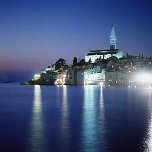 Shot of Harbor Area and Cathedral of St Euphemia at Night by Design Pics Inc