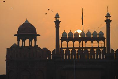 Silhouette of the Lahori Gate of the Red Fort with Sun Rising Behind by Design Pics Inc
