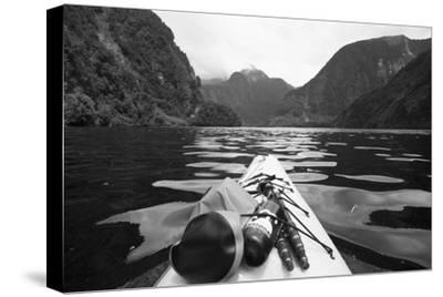 Supplies on the End of a Kayak Going Through a Fjord; Doubtful Sound South Island New Zealand by Design Pics Inc