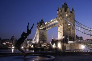 Tower Bridge at Dusk with Dolphin Statue in the Foreground by Design Pics Inc