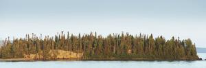 Trees Covering an Island on Lake Superior at Sunset; Thunder Bay, Ontario, Canada by Design Pics Inc