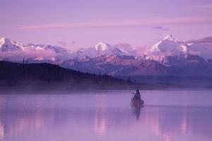 Woman Canoeing in Wonder Lake in the Evening Dnp by Design Pics Inc