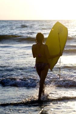 Woman on Beach Carrying Bodyboard; Puerto Vallarta,Mexico by Design Pics Inc
