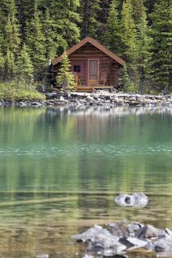 Wooden Cabin Along a Lake Shore by Design Pics Inc