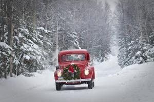 Man Driving A Vintage 1941 Ford Pickup With A Christmas Wreath On The Front During Winter by Design Pics