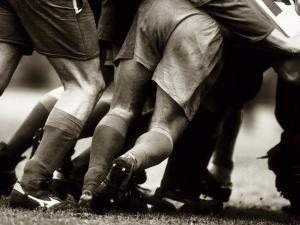 Detail of Feet of a Group of Rugby Players in a Scrum, Paris, France
