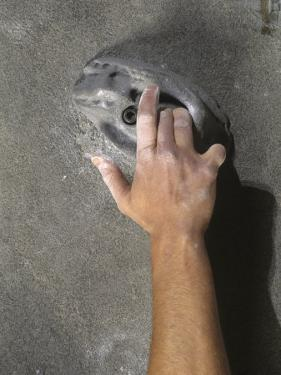 Detail of Hand on Wall Climbing Grip