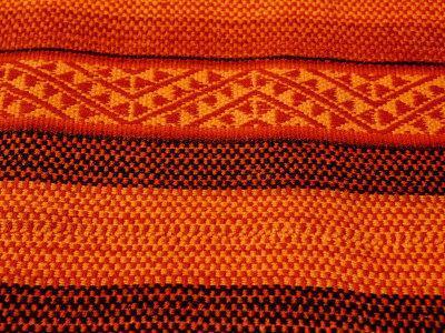https://imgc.allpostersimages.com/img/posters/detail-of-handmade-orange-and-black-wool-textile-blanket-pisac-market-peru_u-L-P2U0GE0.jpg?artPerspective=n