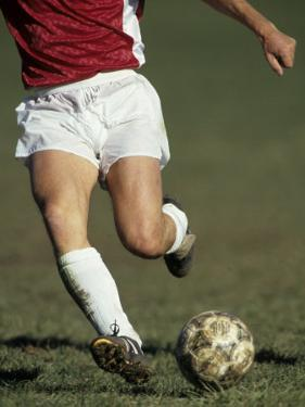 Detail of Male Soccer Player with the Ball