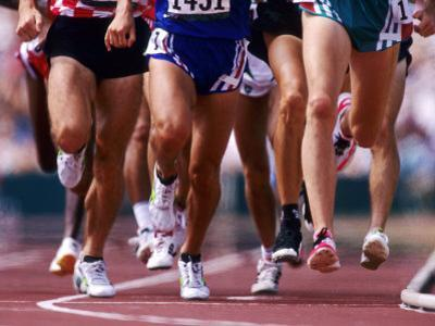 Detail of Runners Legs Competing in a Race