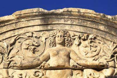 https://imgc.allpostersimages.com/img/posters/detail-of-temple-of-hadrian-ephesus-anatolia-turkey-asia-minor-eurasia_u-L-PNFYNP0.jpg?artPerspective=n