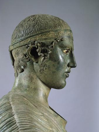 https://imgc.allpostersimages.com/img/posters/detail-of-the-charioteer-of-delphi-also-known-as-heniokhos_u-L-PZO3B20.jpg?artPerspective=n