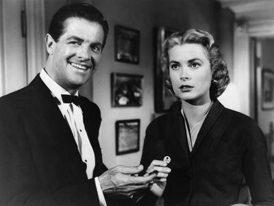 https://imgc.allpostersimages.com/img/posters/dial-m-for-murder-1954-directed-by-alfred-hitchcock-robert-cummings-and-grace-kelly-b-w-photo_u-L-Q1C41UU0.jpg?artPerspective=n