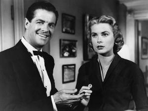 DIAL M FOR MURDER, 1954 directed by ALFRED HITCHCOCK Robert Cummings and Grace Kelly (b/w photo)