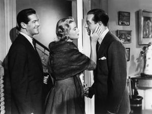 DIAL M FOR MURDER, 1954 directed by ALFRED HITCHCOCK Robert Cummings, Grace Kelly and Ray Milland (