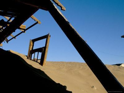https://imgc.allpostersimages.com/img/posters/diamond-mining-ghost-town-kolmanskop-namib-desert-luderitz-namibia-africa_u-L-P1U00S0.jpg?p=0
