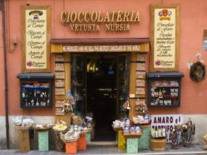 """Chocolateria Shop Front Proclaiming the """"Bestest Chocolate of the World"""" by Diana Mayfield"""