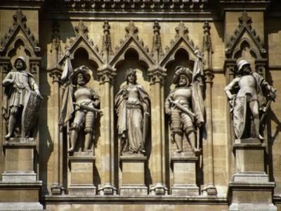 Figures Sculpted in Stone Below the Clock-Tower, Rathaus (1872-73), Vienna, Austria by Diana Mayfield
