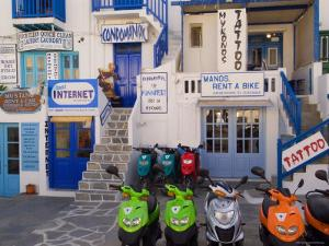 Motorbikes Parked Outside Shops by Diana Mayfield