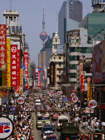 Traffic on Nanjing Road, Shanghai, Shanghai, China by Diana Mayfield