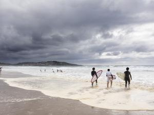 Young Surfers Entering Sea at Meron Beach by Diego Lezama