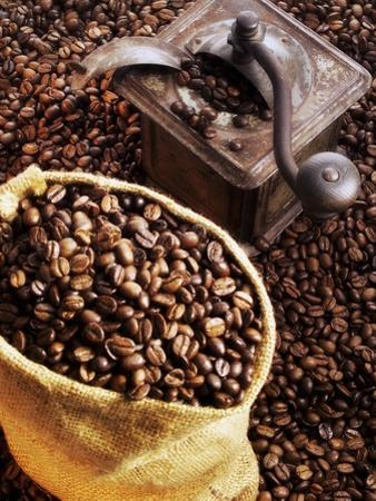Coffee Beans in Sack and in Old Coffee Mill by Dieter Heinemann