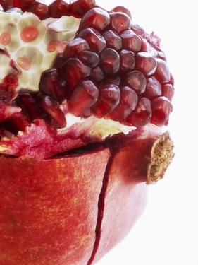 Opened Pomegranate, Close-Up by Dieter Heinemann