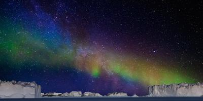 Digital Composite - Aurora Borealis or Northern Lights in Iceland and Icebergs in Greenland