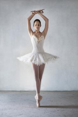 Ballerina Posing in Tutu on Points by Dimitri Otis
