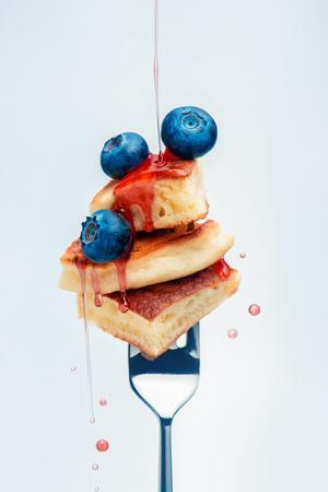 Pancakes with Blueberry and Syrup on Fork