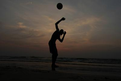 Man Plays Football on Beach in Colombo