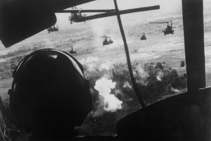 Bell Uh-1 Huey Squadron Firing on Vietcong by Dirck Halstead