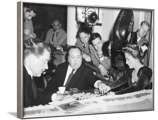 Director Hitchcock Directing a Scrabble Scene with Joan Fontaine in Suspicion--Framed Photo
