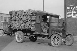District of Columbia Paper Company Is Getting a Delivery of Logs from Which to Manufacture Paper