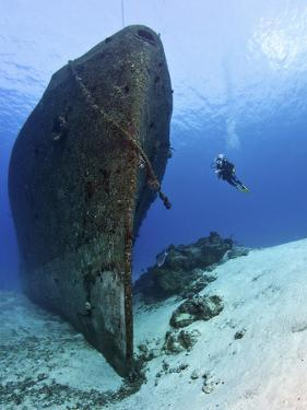 Diver Exploring the Felipe Xicot?Ncatl Shipwreck in Cozumel, Mexico