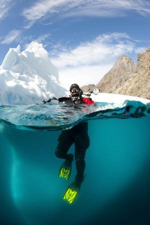 Diver in Front of an Iceberg, Astrolabe Island, Antarctic Peninsula, Antarctica