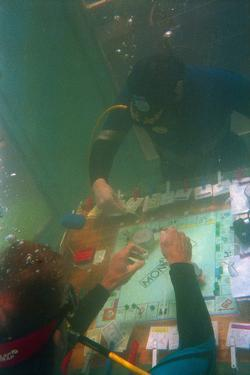 Divers Playing Monopoly Underwater