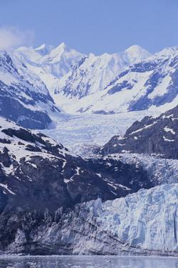 Margerie Glacier Emerging from Mountain Range by DLILLC