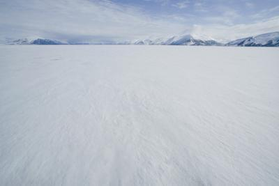 Pack Ice with Mountain Range in Distance by DLILLC