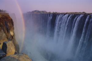 Rainbow over Victoria Falls by DLILLC