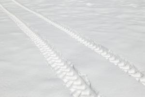 Tire Tracks in Snow by DLILLC