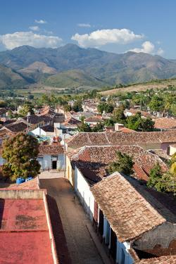 A Roof Top View of Trinidad's Tile Roofs and Surrounding Countryside by Dmitri Alexander