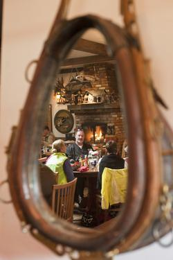 A Western-Themed Mirror Reflects Patrons at a Restaurant in Sun Valley by Dmitri Alexander