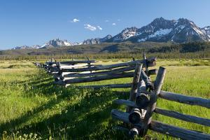 A Wooden Fence Zigzags Toward the Sawtooth Range in Idaho by Dmitri Alexander