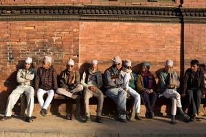 Local Men Sit on a Bench in Patan Durbar Square by Dmitri Alexander