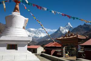 Prayer Flags Fly Above the Tenboche Monastery by Dmitri Alexander