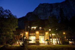 The Historic Awahnee Hotel in Yosemite Glows under a Darkening Sky by Dmitri Alexander